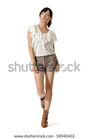 Fashion woman of Asian walking, full length portrait isolated on white background. - stock photo