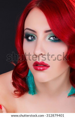 Fashion woman portrait. Beauty model girl with luxurious hair, make up and accessories. Holiday makeup. Bright smoky eyes and red lipstick - stock photo