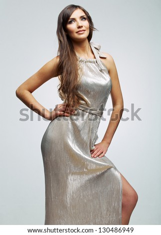 Fashion woman portrait. Female young model. Studio isolated , gray background .