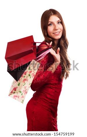Fashion woman portrait isolated. White background. Happy girl hold shopping bag. Red dress. female beautiful model. - stock photo