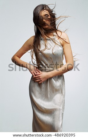 Fashion woman portrait. Studio isolated , gray background . Fashion model studio poses.