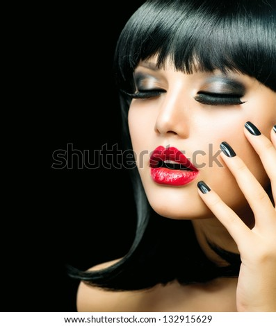 Fashion Woman Portrait. Stylish Model. Beauty Makeup and Manicure. Beautiful Girl with Black Hair, Smoky Eyes, Red Lipstick and Black Nails