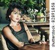 Fashion woman retro portrait in a restaurant - stock photo