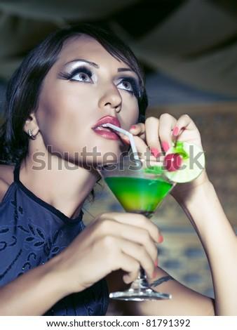 Fashion woman retro portrait with a cocktail - stock photo