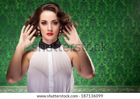 Fashion woman retro style on green vintage background. Studio shooting. Professional make up and hairstyle - stock photo