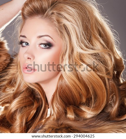 Fashion woman sexy girl beauty model, sensual blonde female with bright makeup and long curly hair, beauty and jewelry model vogue style, young woman in luxury fur coat, studio isolated, series - stock photo