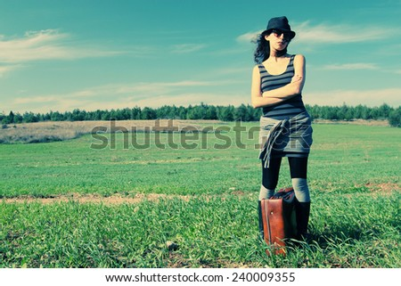 fashion Woman standing in the field - stock photo