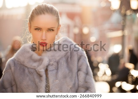 fashion woman walking in the city - stock photo