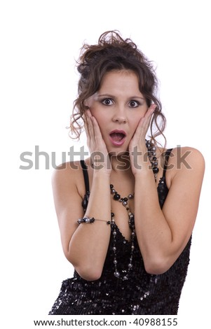 Fashion woman wearing black dress and looking surprised. Gorgeous model is in fashion and express astonishment and looking up. - stock photo