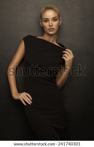 Fashion woman wearing black fashion dress - stock photo
