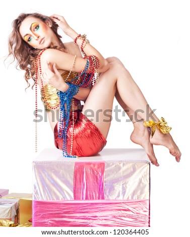 fashion woman with beauty bright make-up sitting on gift box - stock photo