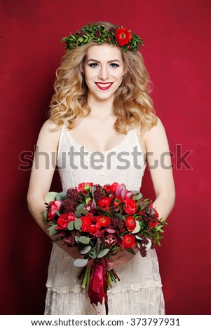 Fashion Woman with Curly Blond Hair. Bride with Flowers - stock photo