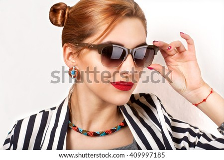 fashion woman with glasses in the studio on a white background, Vogue Style