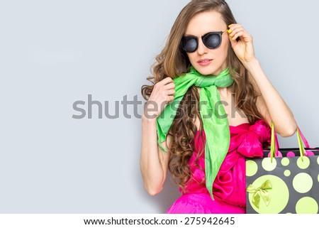 Fashion woman with shopping bags and wearing sunglasses