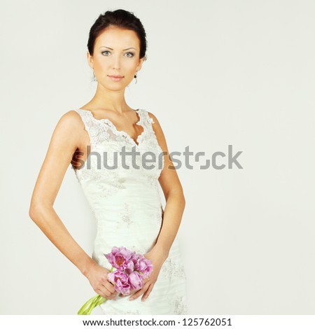 Fashion woman with spring flowers - stock photo