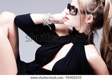 fashion woman with sunglasses portrait, profile, studio shot - stock photo