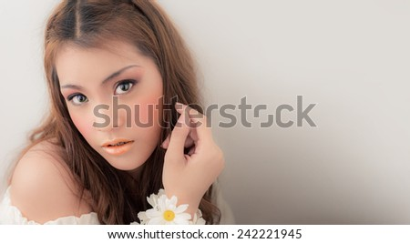 Fashion Women portrait beautiful mouth hands flower Multicultural Asian Caucasian girl on beautiful eyes sparkling. natural beauty - stock photo