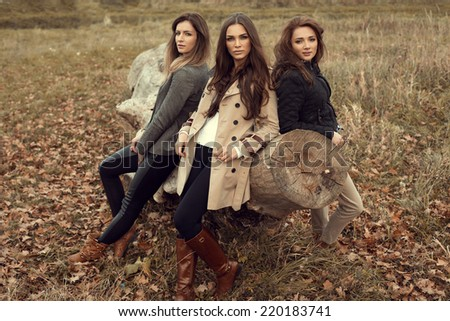 Fashion women posing in autumn scenery - stock photo