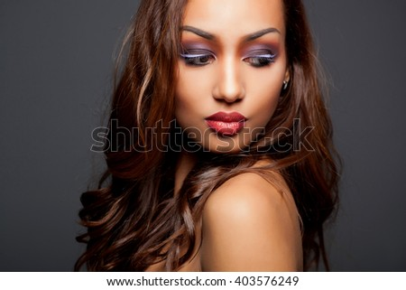 fashion young African woman with creative make-up and curly hair - stock photo