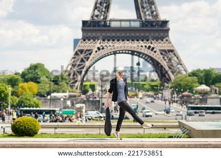 Fashion young blonde woman portrait in front of the Eiffel Tower in Paris, France.  - stock photo