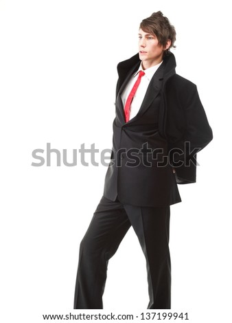 Fashion young businessman black suit casual red tie on isolated white background - stock photo