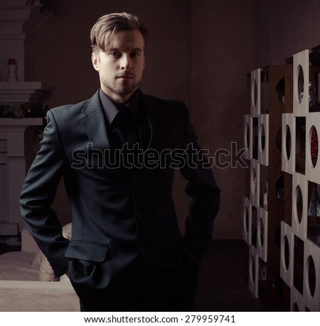 Fashion young man in luxury modern interior  - stock photo