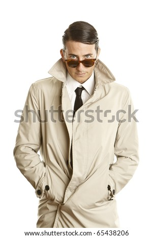 fashion young man with sunglasses and trench coat