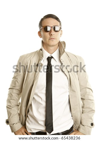 fashion young man with sunglasses and trench coat - stock photo