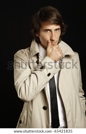fashion young man with trenchcoat - stock photo