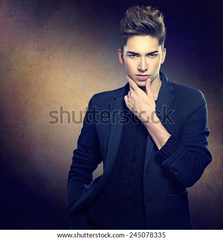 Fashion young model man portrait. Handsome Guy. Vogue style image of elegant young man. Studio fashion portrait.  - stock photo