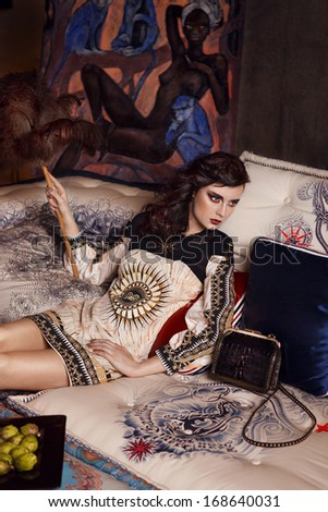 Fashion young model with make up, luxury look n interior - stock photo