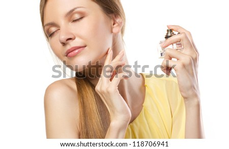 fashion young woman  applying  perfume isolated on white - stock photo