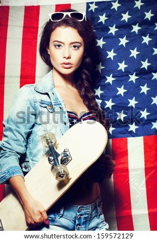 Fashion young woman in sunglasses with national usa flag in background. Lifestyle - stock photo