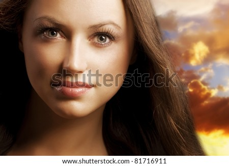 Fashion Young Woman portrait over Beautiful Sky Background - stock photo