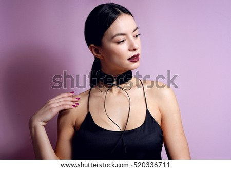 Fashion young woman portrait sensual dark lips with black choker necklace bow accessory.