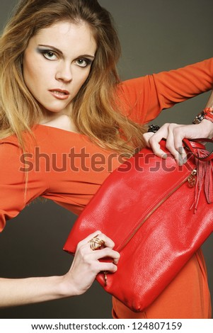 fashion young woman with bag - stock photo