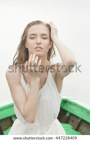 Fashionable and beautiful girl in the boat