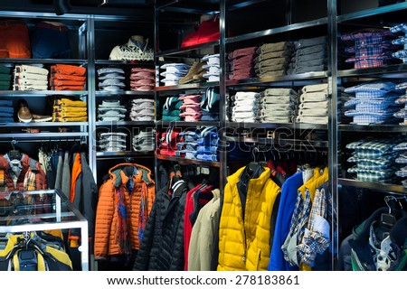 Fashionable apparel store with men shirts   - stock photo
