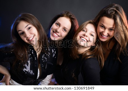 fashionable attractive party young women, over black background - stock photo