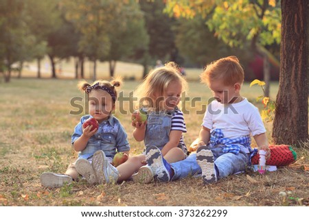 fashionable babies outdoors - stock photo