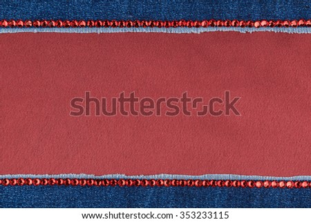 Fashionable background,  jeans and red  rhinestones on a red silk, with space for your text