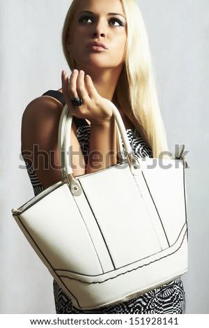 fashionable beautiful blond woman with handbag. shopping - stock photo