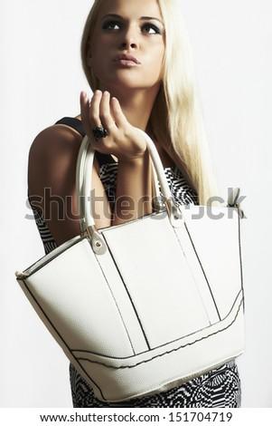 fashionable beautiful blond woman with handbag. shopping. beauty girl. isolate - stock photo