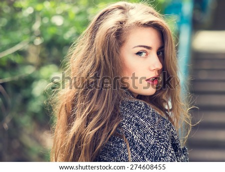 Fashionable beautiful girl on a sunny day in the city - stock photo
