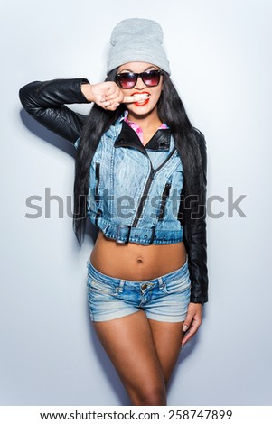 Fashionable beauty. Beautiful young African woman in fashionable style posing against grey background  - stock photo