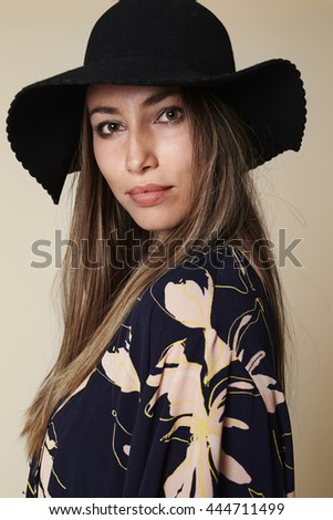 Fashionable beauty in kimono and hat