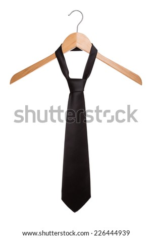 Fashionable black man's tie on a hanger. On a white background. - stock photo