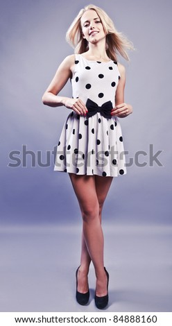 Fashionable blond girl smiling. - stock photo