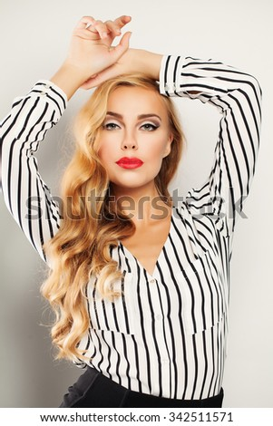 Fashionable Blond Hair Woman with Long Curly Blonde Hairstyle and Makeup - stock photo