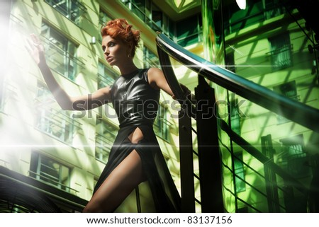 Fashionable blonde beauty in a modern hall - stock photo